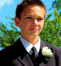 [photo: boy in suit]