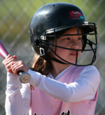 photo: girl batting in almaden valley girls softball league
